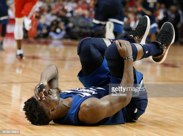 Jimmy Butler of the Minnesota Timberwolves grabs his knee after injuring himself in the third quarter against the Houston Rockets at Toyota Center on...
