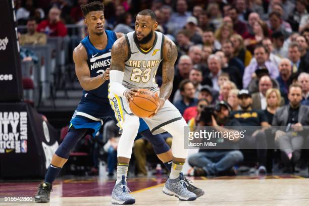 Jimmy Butler of the Minnesota Timberwolves guards LeBron James of the Cleveland Cavaliers during the first half at Quicken Loans Arena on February 7,...