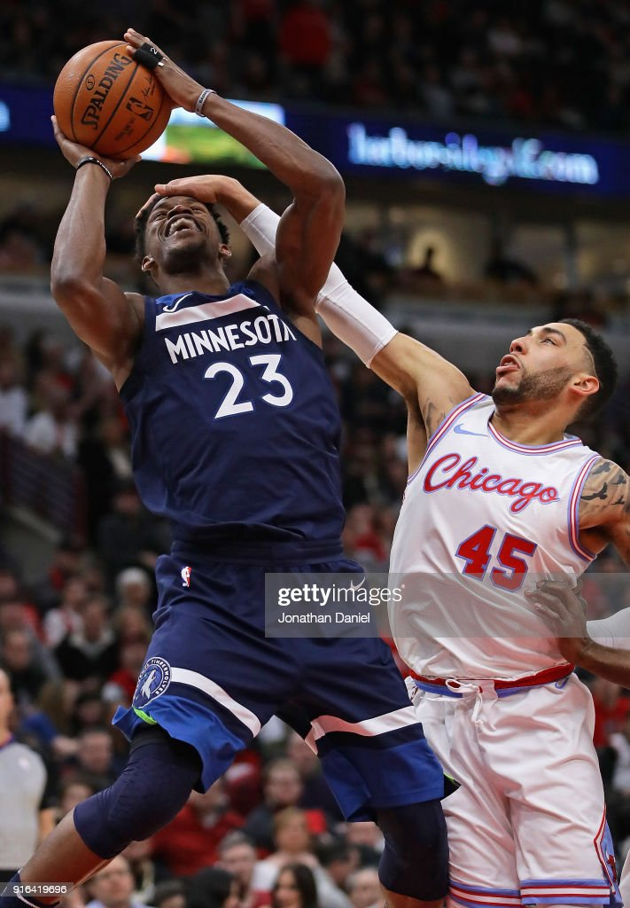 Jimmy Butler #23 of the Minnesota Timberwolves is fouled by Denzel Valentine #45 of the Chicago Bulls at the United Center on February 9, 2018 in Chicago, Illinois. The Bulls defeated the Timberwolves 114-113.