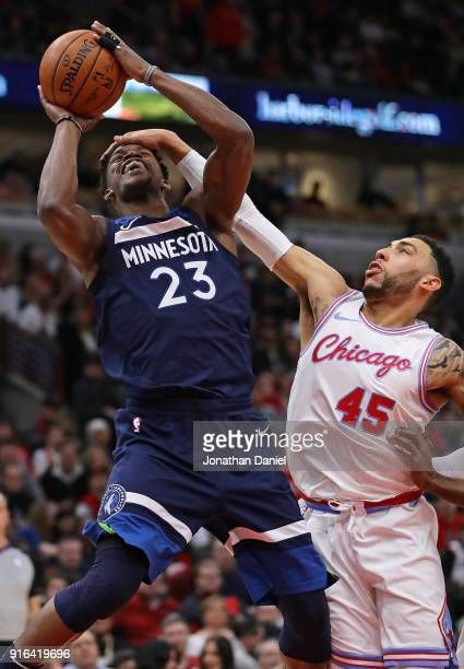 Jimmy Butler of the Minnesota Timberwolves is fouled by Denzel Valentine of the Chicago Bulls at the United Center on February 9 2018 in Chicago...
