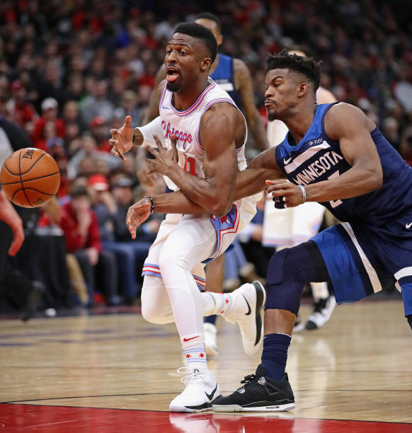Jimmy Butler  23 of the Minnesota Timberwolves knocks the ball away from  David Nwaba   2bb05596488a