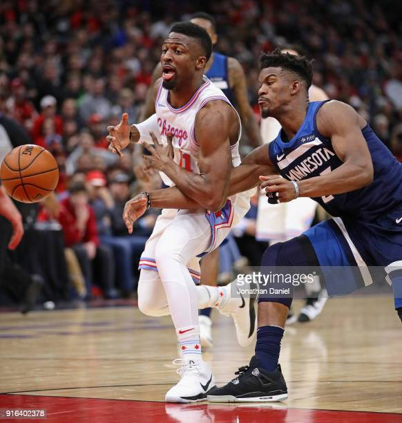 Jimmy Butler of the Minnesota Timberwolves knocks the ball away from David Nwaba of the Chicago Bulls at the United Center on February 9 2018 in...