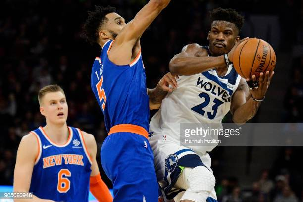 Jimmy Butler of the Minnesota Timberwolves passes the ball away from Courtney Lee of the New York Knicks during the game on January 12 2018 at the...