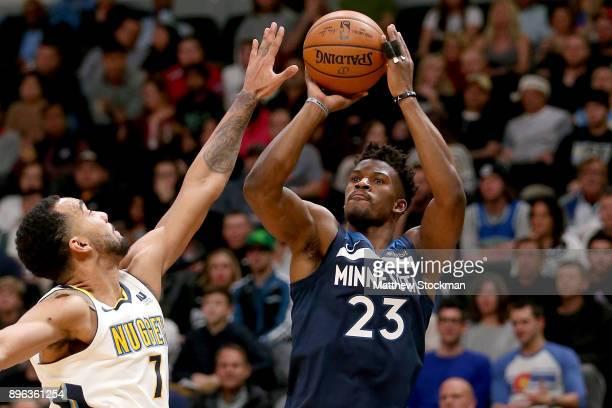 Jimmy Butler of the Minnesota Timberwolves puts up a shot over Trey Lyles of the Denver Nugets at the Pepsi Center on December 20 2017 in Denver...