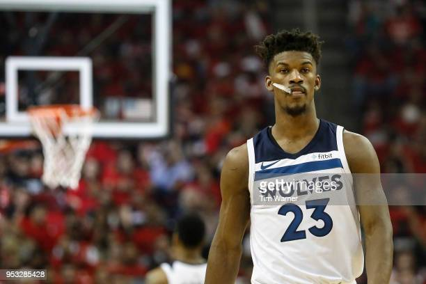 Jimmy Butler of the Minnesota Timberwolves reacts in the first half during Game Five of the first round of the 2018 NBA Playoffs against the Houston...