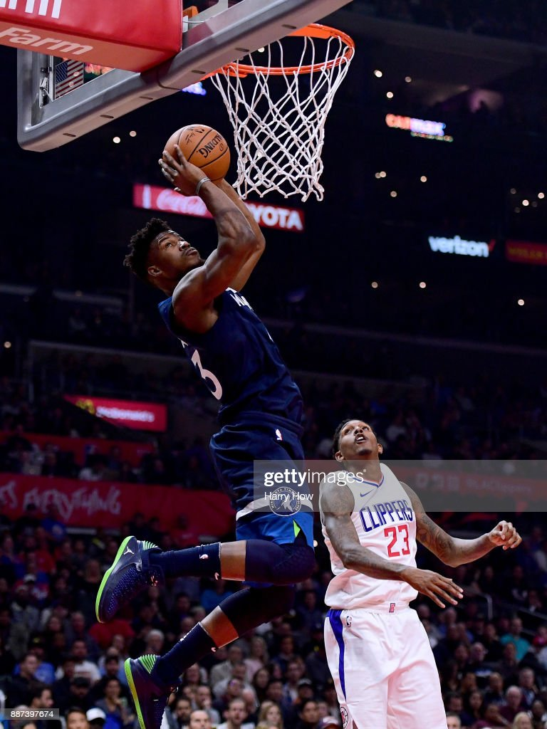 Jimmy Butler #23 of the Minnesota Timberwolves scores on an alley in front of Lou Williams #23 of the LA Clippers during the first half at Staples Center on December 6, 2017 in Los Angeles, California.