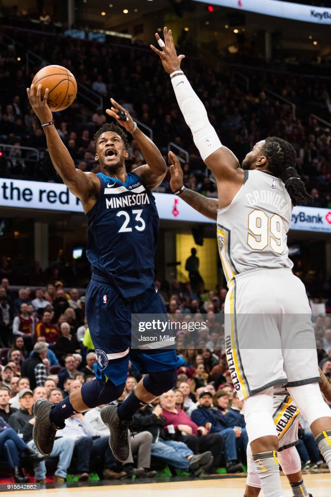 Jimmy Butler #23 of the Minnesota Timberwolves scores over Jae Crowder #99 of the Cleveland Cavaliers during the first half at Quicken Loans Arena on February 7, 2018 in Cleveland, Ohio.