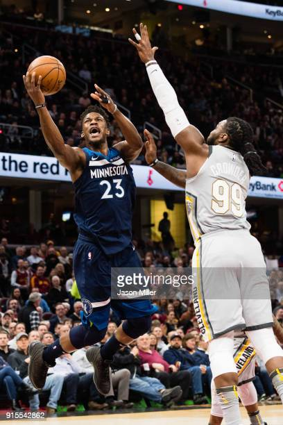 Jimmy Butler of the Minnesota Timberwolves scores over Jae Crowder of the Cleveland Cavaliers during the first half at Quicken Loans Arena on...