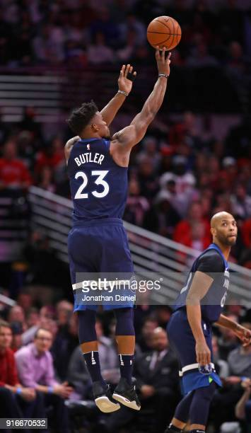 Jimmy Butler of the Minnesota Timberwolves shoots as Taj Gibson watches against the Chicago Bulls at the United Center on February 9 2018 in Chicago...