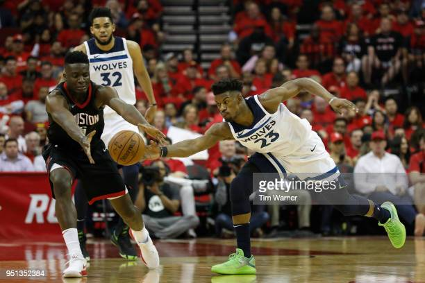 Jimmy Butler of the Minnesota Timberwolves steals the ball from Clint Capela of the Houston Rockets in the second half during Game Five of the first...