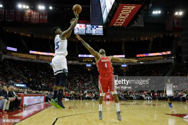 Jimmy Butler of the Minnesota Timberwolves takes a three point shot defended by PJ Tucker of the Houston Rockets in the second half at Toyota Center...