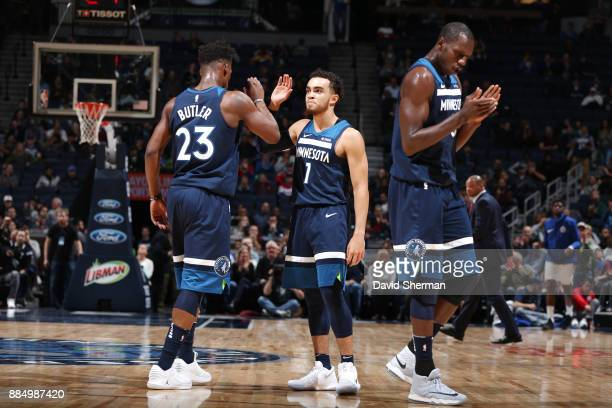 Jimmy Butler of the Minnesota Timberwolves Tyus Jones of the Minnesota Timberwolves and Gorgui Dieng of the Minnesota Timberwolves celebrate on the...
