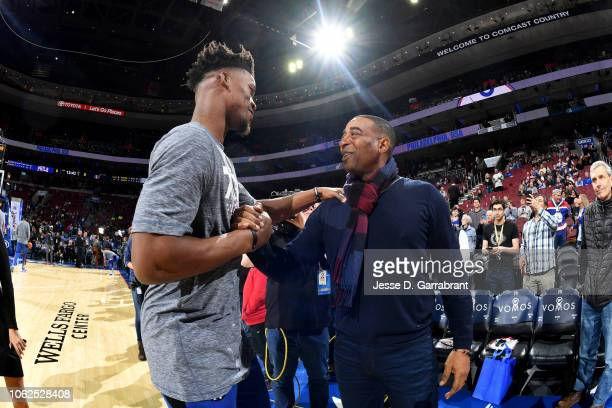 Jimmy Butler of the Philadelphia 76ers and former NFL player Cris Carter talk before the game against the Utah Jazz on November 16 2018 at Wells...