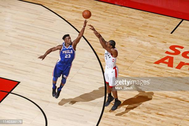 Jimmy Butler of the Philadelphia 76ers contests the shot by Kawhi Leonard of the Toronto Raptors during Game Two of the Eastern Conference Semifinals...