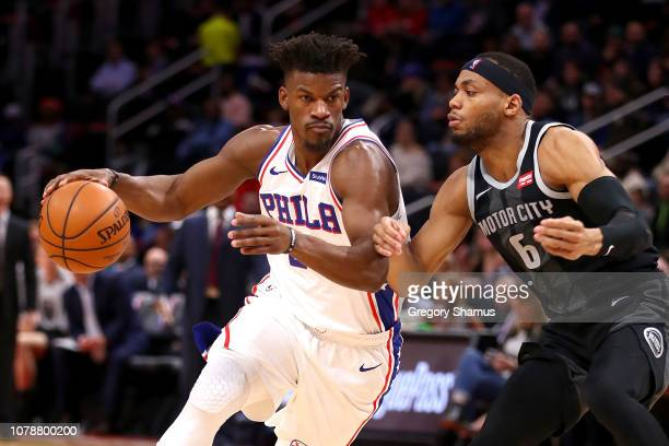 Jimmy Butler of the Philadelphia 76ers drives around Bruce Brown of the Detroit Pistons during the first half at Little Caesars Arena on December 07...