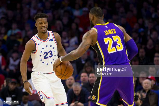 Jimmy Butler of the Philadelphia 76ers guards LeBron James of the Los Angeles Lakers in the first quarter at the Wells Fargo Center on February 10...