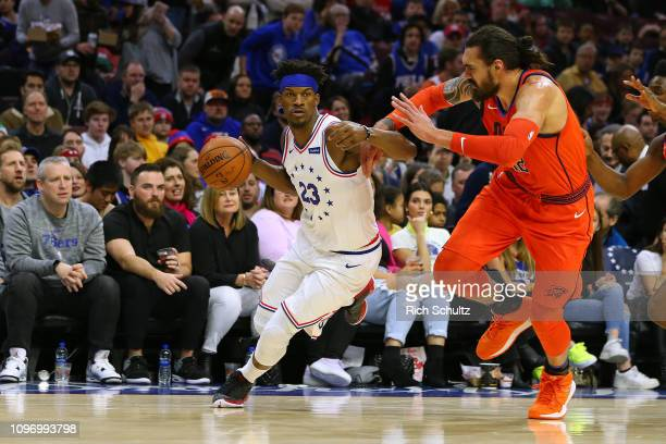 Jimmy Butler of the Philadelphia 76ers in action against Steven Adams of the Oklahoma City Thunder during a game at Wells Fargo Center on January 19...