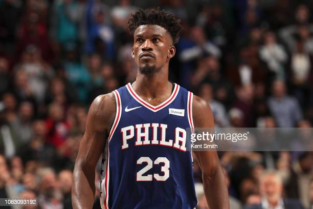 Jimmy Butler of the Philadelphia 76ers looks on during overtime in the game against the Charlotte Hornets on November 17 2018 at Spectrum Center in...