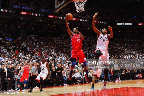 Jimmy Butler of the Philadelphia 76ers shoots a lay up to tie the game late in the fourth quarter against the Toronto Raptors during Game Seven of...