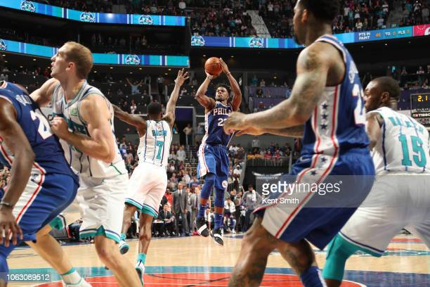 Jimmy Butler of the Philadelphia 76ers shoots the ball against the Charlotte Hornets on November 17 2018 at Spectrum Center in Charlotte North...