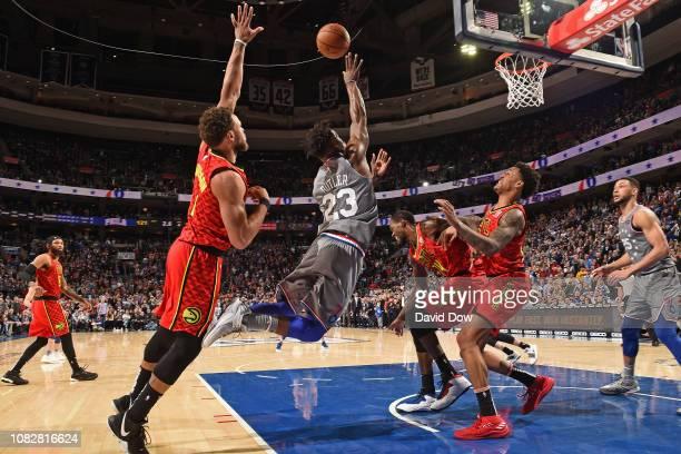 Jimmy Butler of the Philadelphia 76ers shoots the ball against the Atlanta Hawks on January 11 2019 at the Wells Fargo Center in Philadelphia...