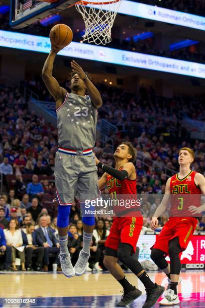 Jimmy Butler of the Philadelphia 76ers shoots the ball against Trae Young and Kevin Huerter of the Atlanta Hawks at the Wells Fargo Center on January...