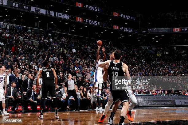 Jimmy Butler of the Philadelphia 76ers shoots the gamewinning shot against the Brooklyn Nets on November 25 2018 at Barclays Center in Brooklyn New...