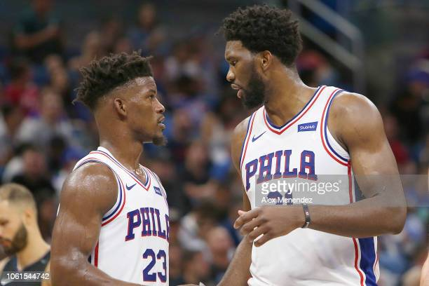 Jimmy Butler of the Philadelphia 76ers speaks with Joel Embiid of the Philadelphia 76ers during a NBA game against the Orlando Magic at Amway Center...