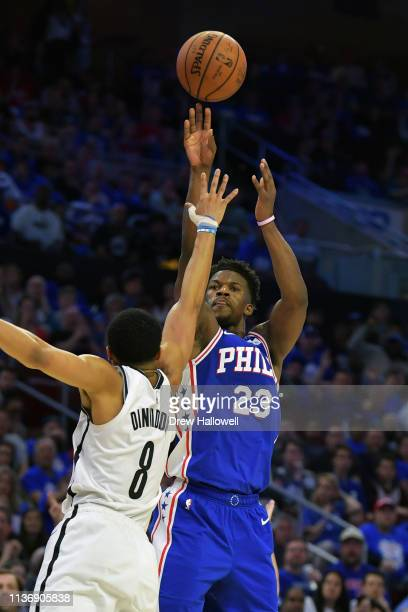 Jimmy Butler of the Philadelphia 76ers takes a shot over Spencer Dinwiddie of the Brooklyn Nets in the second half during Game One of the first round...