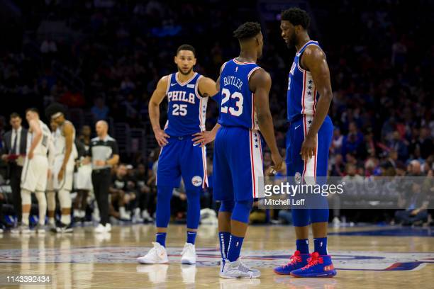 Jimmy Butler of the Philadelphia 76ers talks to Ben Simmons and Joel Embiid against the Brooklyn Nets in Game Two of Round One of the 2019 NBA...