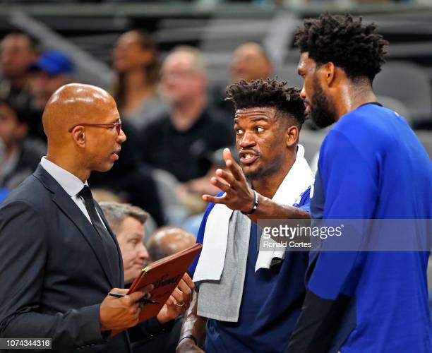 Jimmy Butler of the Philadelphia 76ersC talks with assistant coach Monty Williams as Joel Embiid during game against the San Antonio Spurs at ATT...