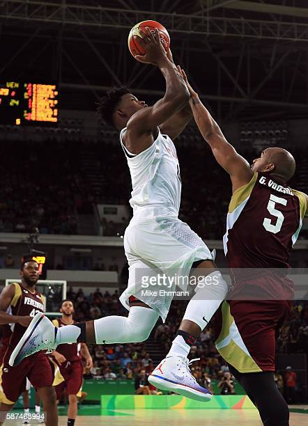 Jimmy Butler of United States shoots over Gregory Vargas of Venezuela during the Men's Priliminary Round between the United States and Venezuela on...