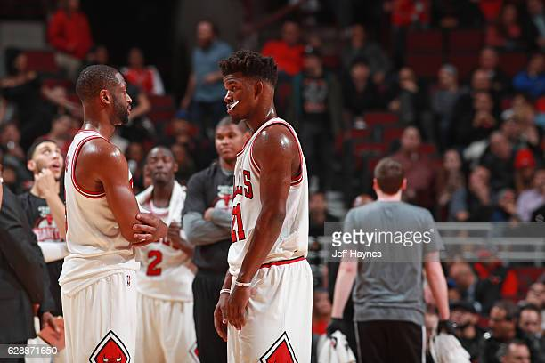 Jimmy Butler talks with Dwyane Wade of the Chicago Bulls during the game against the Portland Trail Blazers on December 5 2016 at the United Center...