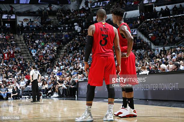 Jimmy Butler talks with Dwyane Wade of the Chicago Bulls during the game against the San Antonio Spurs on December 25 2016 at the ATT Center in San...