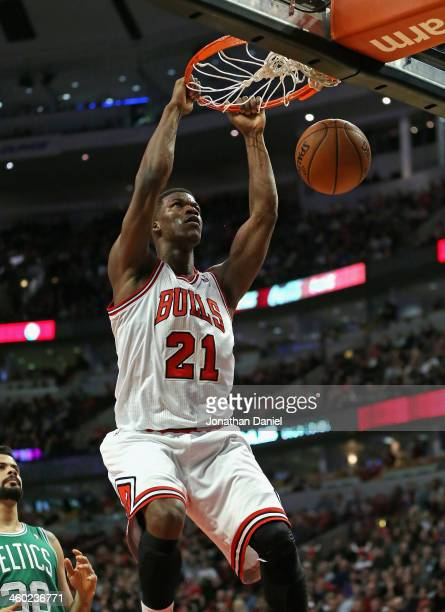 Jimmy Butler the Chicago Bulls dunks against the Boston Celtics at the United Center on January 2, 2014 in Chicago, Illinois. The Bulls defeated the...