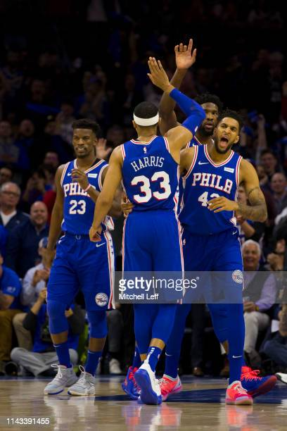 Jimmy Butler Tobias Harris Jonah Bolden and Joel Embiid of the Philadelphia 76ers react against the Brooklyn Nets in Game Two of Round One of the...