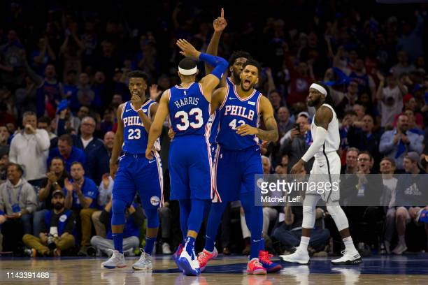 Jimmy Butler Tobias Harris Jonah Bolden and Joel Embiid of the Philadelphia 76ers react in front of DeMarre Carroll of the Brooklyn Nets in Game Two...