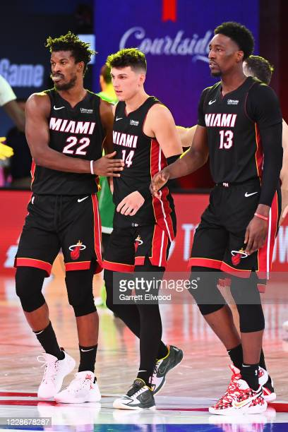 Jimmy Butler, Tyler Herro and Bam Adebayo of the Miami Heat walk off the court after Game Four of the Eastern Conference Finals against the Boston...