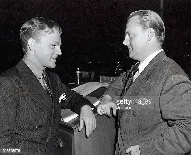 1940 Jimmy Cagney star and Bill Cagney associate producer of Warner Bros movie 'City for Conquest' talk over movie matters on the set Jimmy and Bill...