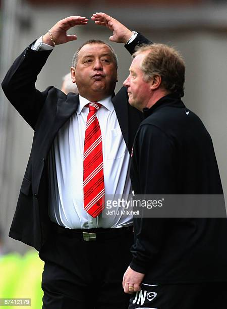 Jimmy Calderwood coach of Aberdeen react during the Scottish Premier League match between Rangers and Aberdeen at Ibrox Stadium on May 16 2009 in...