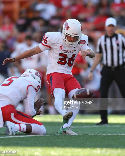 Jimmy Camacho of the Fresno State Bulldogs attempts an extra point during the second quarter of the Hawaii Bowl against the Houston Cougars at Aloha...