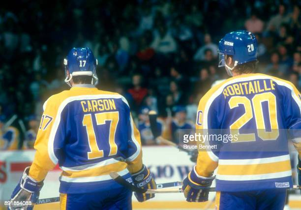 Jimmy Carson and Luc Robitaille of the Los Angeles Kings skate on the ice during an NHL game against the Philadelphia Flyers circa 1988 at the...
