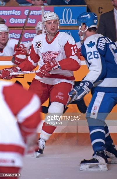 Jimmy Carson of the Detroit Red Wings skates against Mike Krushelnyski of the Toronto Maple Leafs during NHL game action on February 11 1992 at Maple...