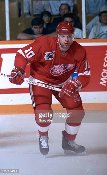 Jimmy Carson of the Detroit Red Wings skates up ice against Toronto Maple during game action on October 26 1991 at Maple Leaf Gardens in Toronto...