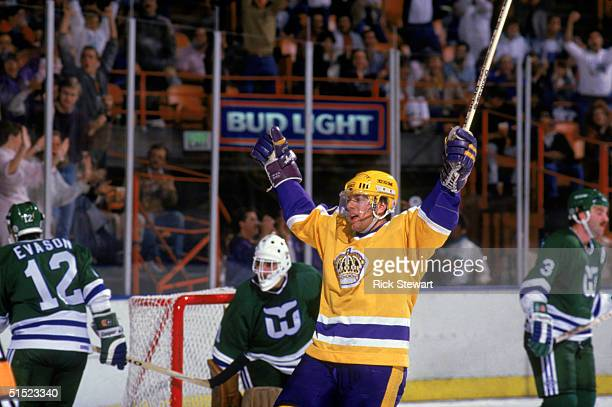 Jimmy Carson of the Los Angeles Kings celebrates during a game against the Hartford Whalers in 1986 at the Great Western Forum in Inglewood California