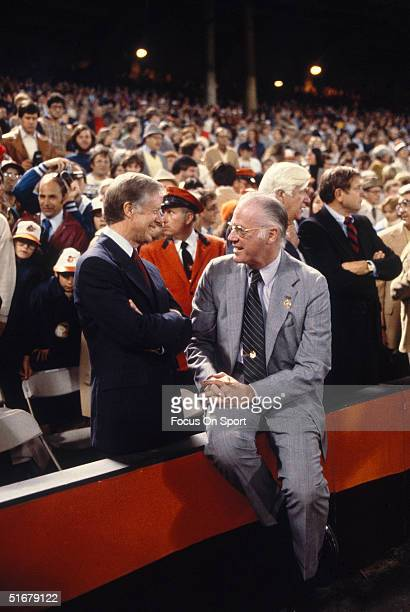 Jimmy Carter and Bowie Kuhn converse during the 1979 World Series at Memorial Stadium in Baltimore Maryland