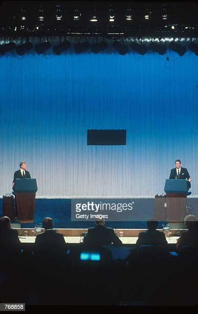 Jimmy Carter and Ronald Reagan debate each other from separate podiums October 31 1980 prior to the 1980 presidential election