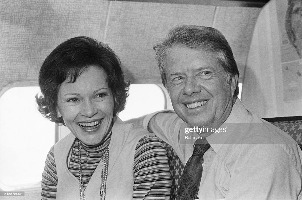 Jimmy Carter, Democratic presidential candidate, and his wife, Rosalynn, share a moment aboard his campaign plane