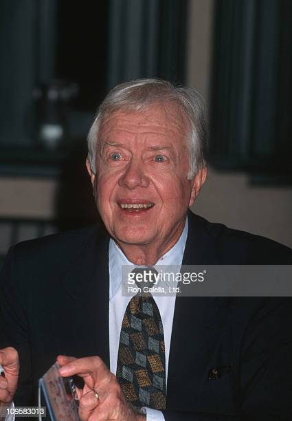 Jimmy Carter during The Little Baby Snoogle Fleejer Autographing Party December 13 1995 at Barnes Noble Bookstore in New York City New York United...