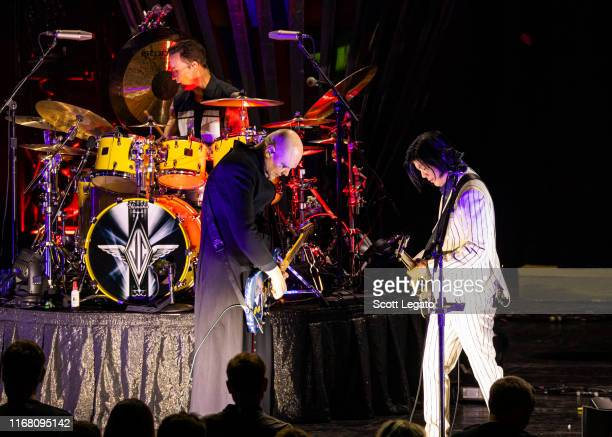 Jimmy Chamberlin Billy Corgan and James Iha of Smashing Pumpkins perform at DTE Energy Music Theater on August 14 2019 in Clarkston Michigan